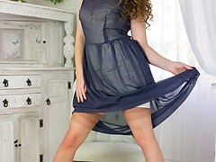 Brook is properly dressed in full skirt dress, nylon slip and waist nipping merry widow and full...