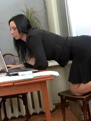 Anna\'s slave is lying at her feet and she\'s trying to finish her work with the computer