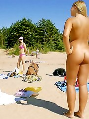 Sultry blonde teen strips and tans on a nude beach