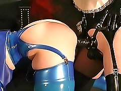 Dominatrix makes a slave girl to suck a strapon dildo then penetrates her pussy