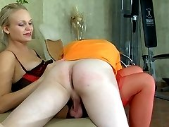 Sporty guy gets collared and ass-fucked by a lady with a big strapon dildo
