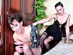 Dolled-up sissy guy gets butt fingered by a chick thru his ripped open hose