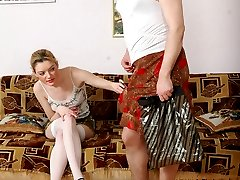 Lewd sissy wearing lacy clothes and spreading his legs for strap-on fucking