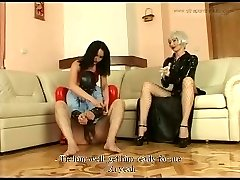 Two latex-loving dominatrices skewer a submissive guy with their strap-ons