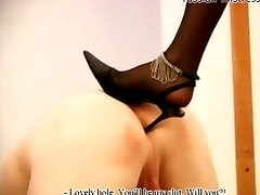 Mature domina sticks her spike heel into slaves ass before throat-fucking him with a large...