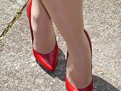 Gorgeous and very cute Iona flashes her sexy legs and beautiful red high stiletto heels