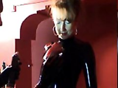 Kinky bondage lady in hot tight black latex uniform