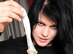 Horny babe in black pantyhose fills a condom with cum then drinks it down
