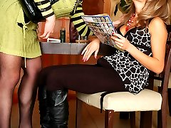 Freaky sissy guy in a funky female outfit getting relaxing strap-on massage