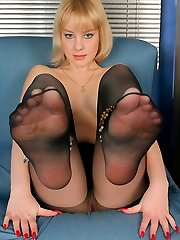 Kinky blonde gal sliding her hands pantyhose waistband to squeeze her booty