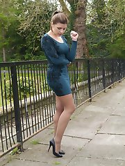 Hot babe Naomi is outdoors in a short tight dress showing off her sexy long nylon encased legs with some high pointed stiletto heels