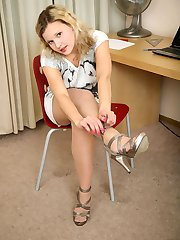 Frisky girl takes off high heels itching to play with her pantyhosed feet