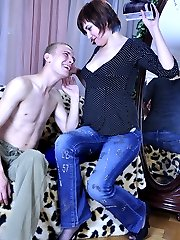 Curvy gal treats a boy to a footjob milking him with her soft nyloned feet