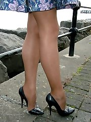 Carrie takes in a stunning view, so why don\'t you of her? She wearing her silky nylons and black stiletto heels just for you