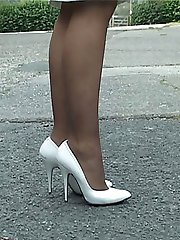 Lovely Iona takes a stroll out in her sexy white stilettos with some close up foot teasing on...