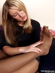 Horny gals in stiletto heel shoes taking nyloned feet into their hot mouths
