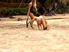 Blonde mistress rides her slaves back and makes him eat her pussy right on the beach