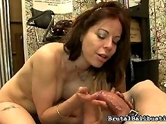 Kora Peters is getting ready in her dressing room for her next ball busting scene. She isn't alone. The cleaning boy, trying his best to sweep, can't help but watch this cock and ball femdom.