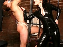 Sexy dominatrix Christian Aguchi punishes her bound malesub with her whip and humiliation