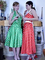 Two pretty girls in retro style gowns enjoy ass fingering and strapon anal