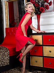 Looking the Hollywood bombshell in a scarlet full skirted frock with matching patent stilettos....