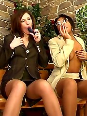 Brown chick in suntan nylons gets to dildo stuffing with a white lez girl
