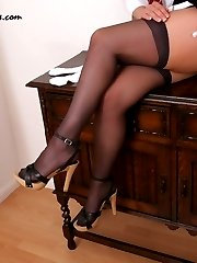 St Trinians girl taking off her stockings