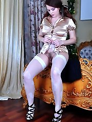 Pigtailed girl changes her silky robe for daywear and cute white stockings