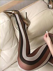 Brunette spreading fashion pantyhosed legs