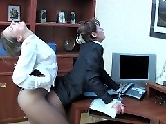 Female co-workers in classy hose savoring hot cuddles and kisses in office