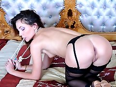 Hot babe strips her animal print gown for some pussy fingering in stockings