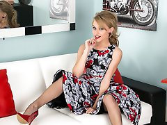 In a full skirted frock, brown fully fashioned nylons and red patent leather sling backs Chloe...