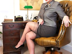 Heres Beth at her desk clad in vintage lingerie with sheer grey FF nylons underneath her smart...