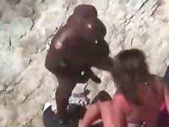 White girl fucks with her black boyfriend at beach voyeur