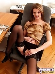 Hot secretary in stockings spreading her legs and showing her sexy upskirt