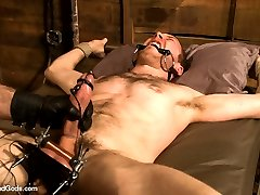 House slave Cody Allen nervously awaits as he hears the footsteps of his master Spencer Reed....