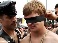 The streets are filled with thousands of people. Master Avery ties up Derek Pain in the middle...