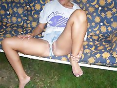 Skank spreads pussy indoors and outdoors