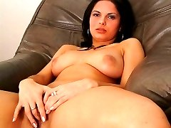 Busty temptress spreads wide and masturbates her hairy pleasure hole.