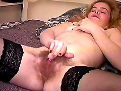 Young hairy girl fingering and playing with double dildo