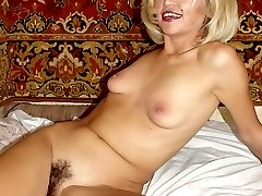 Petite blonde acting sexy and stripping off her clothes to play with her thick black bush