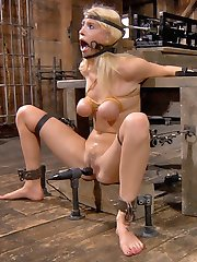 Allie James is locked into our Automatic-Blow-Job-Machine. It's a devious device designed to lock her head in place, her mouth open and her neck working. It starts off slow, just getting her to keep a rhythm. It controls how fast and how deep she goes. She is so excited to be used like this that when we cum in her open mouth she has her own incredible orgasm at the same time.