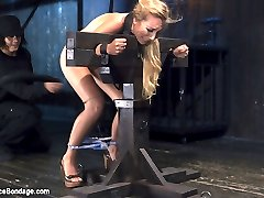 Emmas petite body looks amazing covered in hard steel and leather. Her body is restrained to...