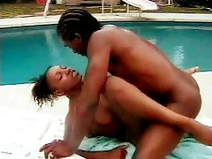 Curly and slim ebony chick in a sadistic pounding session by the swimming pool.