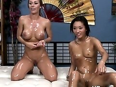Oil filled pussy gets probed by sex toy
