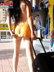 Her mini dress hides nothing! Hot public upskirt