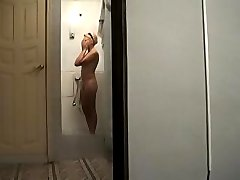 Sexy doll caught on tape taking a shower