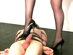 mistress playing with her bound  up slave
