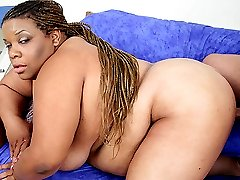 Flabby black babe ChocLick lets a stud fill her mouth and pussy with his hard and meaty cock