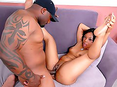 Sexy black chick gets a huge dong pummeling her hot pussy